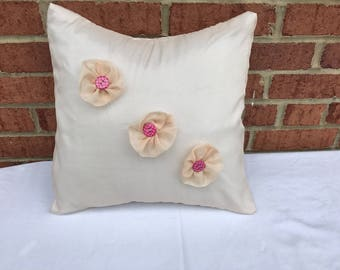 Hand-designed flowers on Pillow cover.