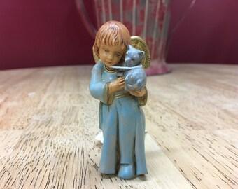 Angel holding a kitten figure