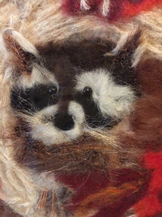 Racoon in tree, artistically needle felted by the artist
