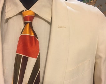 Majestic 1950s dinner jacket; a cream color
