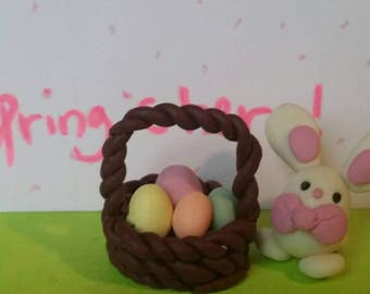 Easter bunny and a basket of easter eggs