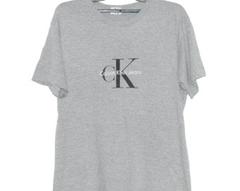 Vintage CK Calvin Klein Sport New York Jeans Couture 90's Big Logo Gray Hip Hop Rap Swag Tee T shirt Size Large Great Condition