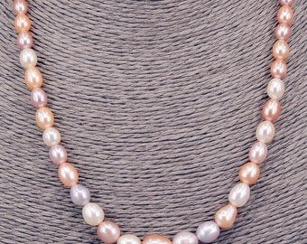 String of pearls Oval 4-9 mm chain with Pearl PKE104
