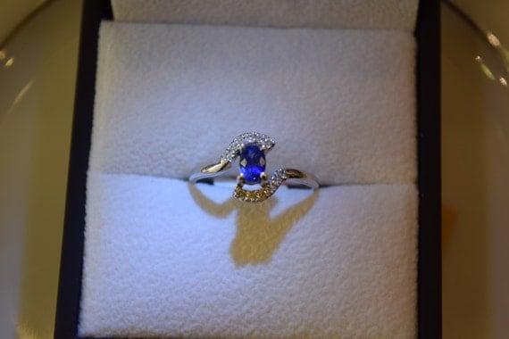 simple elegant blue sapphire engagement ring