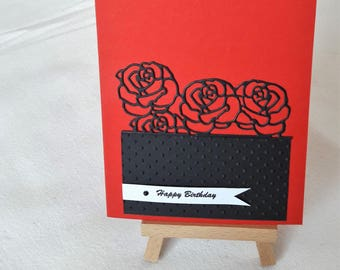Birthday card - friezes of black roses on red background