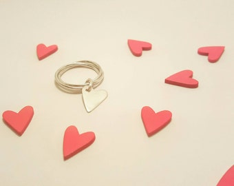 Silver triple ring with heart charm.