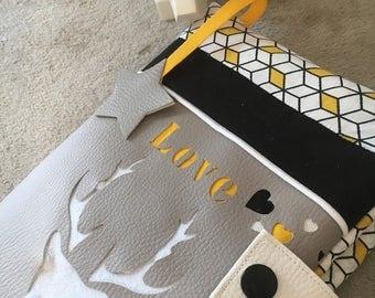 Yellow and grey deer health book