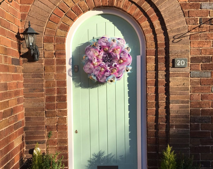 Gorgeous pale purple with clear star door wreath