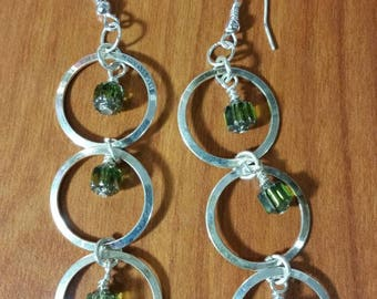 Green cathedral beads with silver circles earrings.