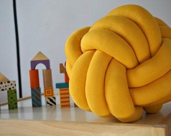 Yellow knot cushion