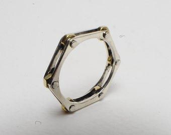 Hexagonal ring in sterling silver with brass nuts