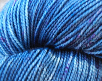 Hand-dyed Superwash Sock Yarn (#1) | Tonal Blues with specks of purple and teal - 100g