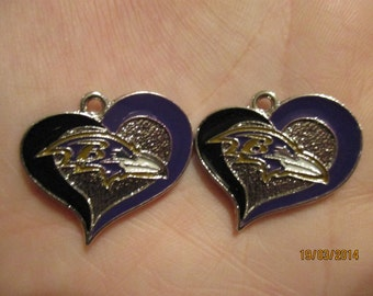 Set of 2 Baltimore Ravens heart charms.