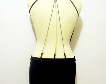 Evening/clubwear dress sexy black neck cowl/drape to backless silver strings