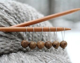 8 Wooden knitting stitch markers on a bracelet
