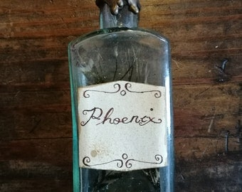 Phoenix Feather Antique Potion Bottle