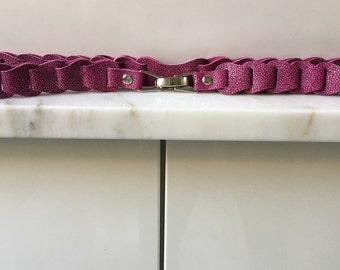 Pink print leather belt race