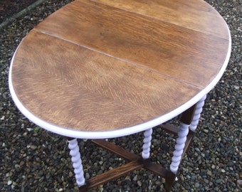 Barley twist drop leaf table restored with pastel pink features