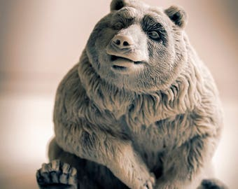 Great brooding figure of a bear made of marble.