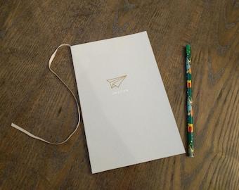 Paperback Paper-plane Notebook