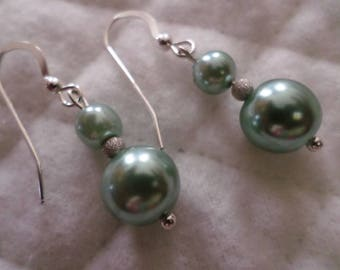 Sterling Silver With Ice Blue Beads Pierce Earrings