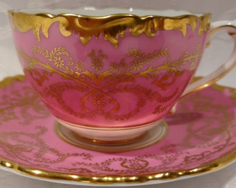 Beautiful Coalport ''Anniversary'' Pink and Gold Tea Cup and Saucer