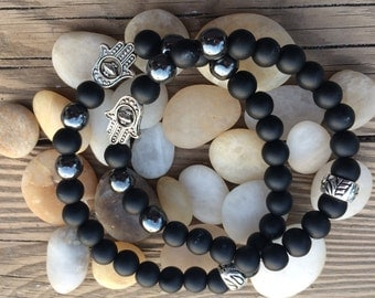Matte Onyx with Hematite and silver tone Chamsah for guys and gals to help guide mindfulness and stress relief