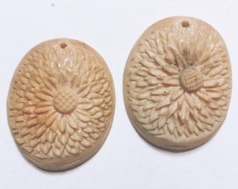 Set of Carved Bone Pendants