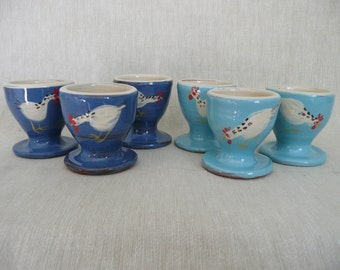 Set of four pottery egg cups. Egg cups with chicken. Blue eggcups. Turquoise egg cups