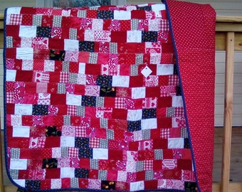 Red Heart patchwork lap quilt