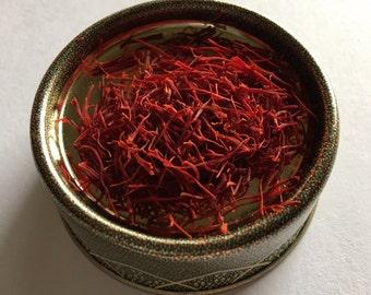 Organic, fair trade, premium Sargol saffron, grown and harvested in Iran. (Half Gram)