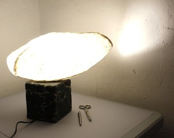 White lamp on black ceramic base.Table Lamp Itsas Erotika.  Model: Muxkullu.