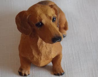 A superb figure of a Dachshund dog.
