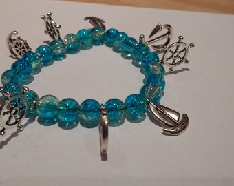 Sea Nautical Style  Bracelet With Silver Charms and Deep Blue Beads.