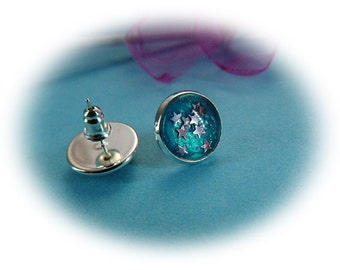 Silver earrings with glass cabochon turquoise glitter star motif