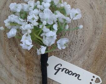 Handmade Gypsophila buttonhole with black organza ribbon finish