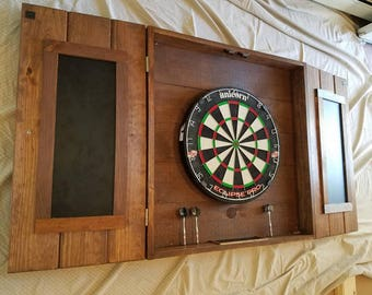 Beautiful Custom hand made dart board cabinet   dart brd  knobs, crafted in our wood craft shop, with chaulk tray at bottom
