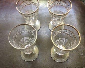 Set of 4 Vintage gold circled cordial glasses.