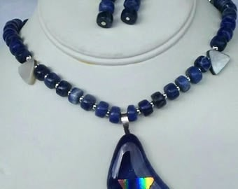 Fused glass dichroic pendant necklace has sodalite and shell beads with silver tone spacers.  Original unique one of a kind plus earrings