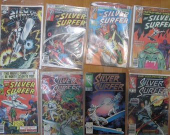 Silver Surfer# 1 comic book plus lot of 7 other silver surfer comics 70s and 80s. Lot of 8 retro comics