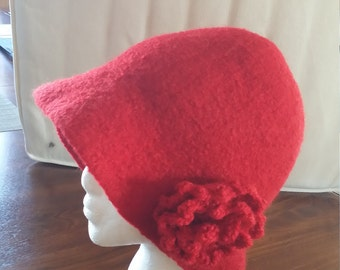 knitted and felted hat with decorative flower