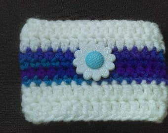 Flowered white crochet cup cozy
