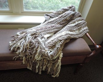 "crocheted tan and white throw with fringe, 41"" by 65"" with 10"" fringe"