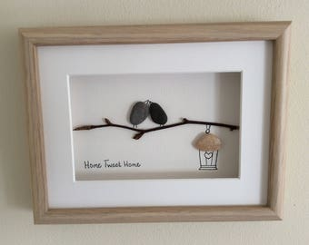 Pebble art picture of two birds 'Home Tweet Home'