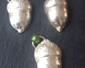 Heavy silver acorn.