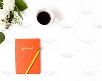 Orange Notebook with Pencil and Coffee