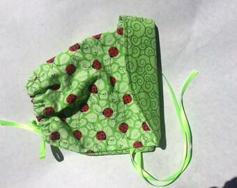 Reversible Green Ladybug and Swirls Baby Bonnet