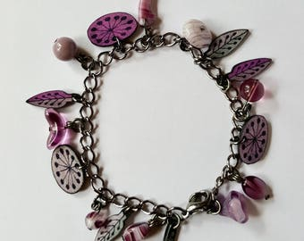 Purple charm bracelet with glass beads and hand made plastic charms