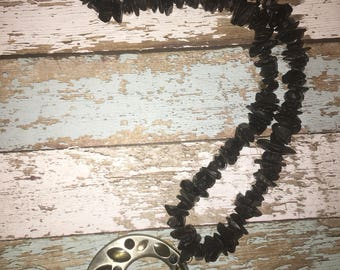 Black and silver beaded necklace with pendant