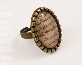 """Note"" - manuscript under glass ring"